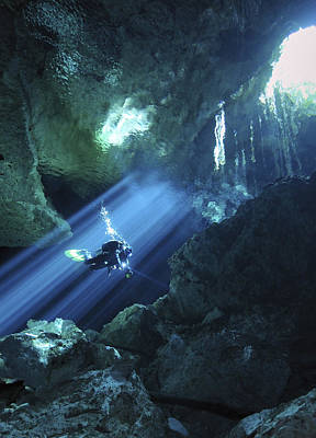 Diver Silhouetted In Sunrays Of Cenote Print by Karen Doody