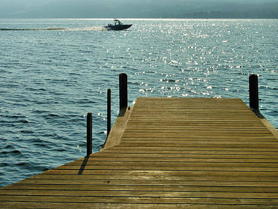 Finger Lakes Photograph - Dock And Speedboat by Steven Ainsworth