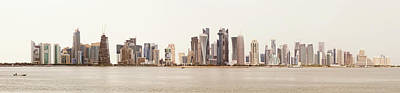 Photograph - Doha Skyline Against A White Sky by Paul Cowan