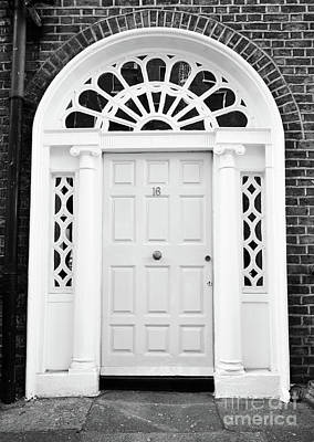 Photograph - Doors Of Dublin Ireland Classic Georgian Style With Columns And Ornate Transom Black And White by Shawn O'Brien