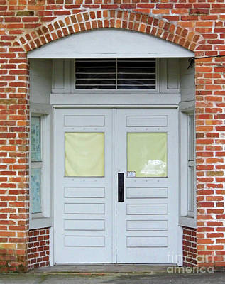 Photograph - Double Doors In The Brick Building by D Hackett