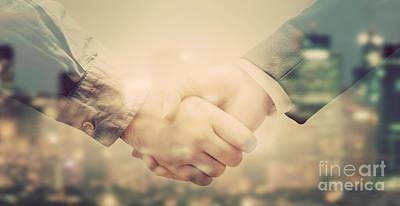 Buy Photograph - Double Exposure Of Business People Handshake On Big City Background by Michal Bednarek