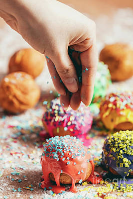 Photograph - Doughnuts Sprinkled By A Woman With Sugar Sprinkles. by Michal Bednarek