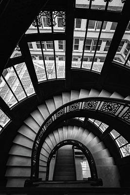 Photograph - Down The Rookery Building Winding Staircase And Windows In Black And White by Anthony Doudt