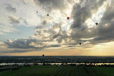 Photograph - Dramatic Sky Full Of Hot Air Balloons by Georgia Mizuleva