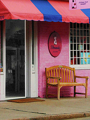 Businesses Photograph - Dress Shop With Orange And Blue Awning by Susan Savad