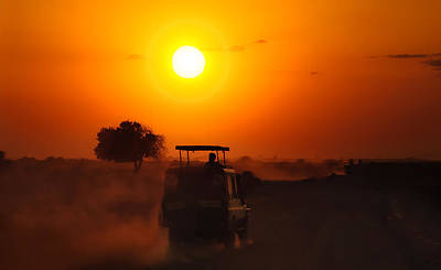 Photograph - Driving Into A Glowing African Sunset by Mitchell R Grosky