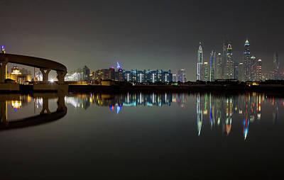 Photograph - Dubai City Skyline Night Time Reflection by Andy Myatt