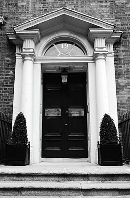 Photograph - Dublin Doors Georgian Style With Roman Columns Ireland Black And White by Shawn O'Brien