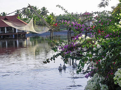 Photograph - Ducks, Fishing Net, Flowers, Water And Cottages Make A Great Pho by Ashish Agarwal