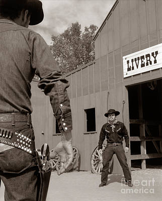 Livery Stable Photograph - Dueling Cowboys, C.1950-60s by D. Corson/ClassicStock
