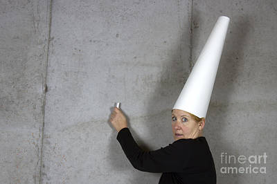 Dunce Cap Photograph - Dunce Cap On Woman Writing On Wall by Karen Foley