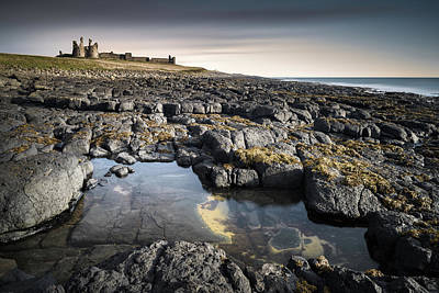 Battlements Photograph - Dunstanburgh Castle by Dave Bowman