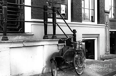 Photograph - Dutch Bike Waiting Mono by John Rizzuto