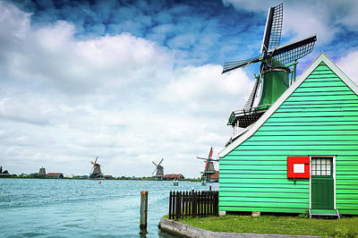 Photograph - Dutch Windmills From Zaanse Schans, Amsterdam, The Netherlands by Alfio Finocchiaro
