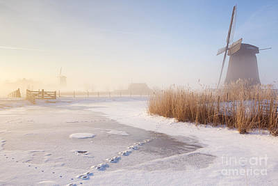 Netherlands Photograph - Dutch Windmills In A Foggy Winter Landscape In The Morning by Sara Winter