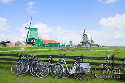 dutch windmills with bikes in Zaanse Schans Art Print by Anastasy Yarmolovich