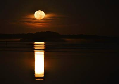 Photograph - Morning Moon - A Large Moon Reflects Off Of A Calm Bay As It Hangs In The Clouds Above The Horizon by William Bartholomew