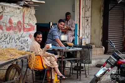 Photograph - Early Morning Tea And Bread At Street Side Stall Karachi Pakistan by Imran Ahmed