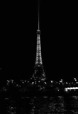 Photograph - Eiffel Tower And Searchlight At Night From The Seine River Paris France Black And White by Shawn O'Brien