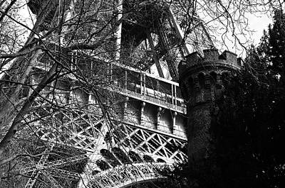 Photograph - Eiffel Tower First Floor Through Branches With Castellated Tower In Foreground Black And White by Shawn O'Brien
