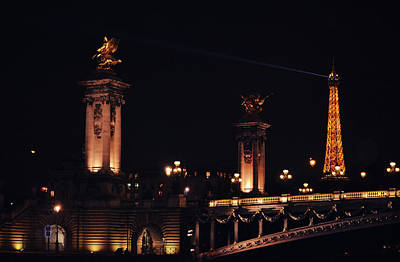 Photograph - Eiffel Tower With Searchlight And Pont Alexander Columns At Night From The Seine River Paris France by Shawn O'Brien