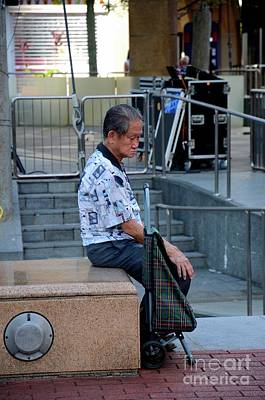Photograph - Elderly Chinese Man Sits And Contemplates Life Singapore by Imran Ahmed