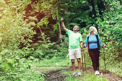 Photograph - Elderly Couple Admiring Nature And Walking by Michal Bednarek