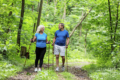Photograph - Elderly Couple Enjoying Summer Walk In The Forest. by Michal Bednarek