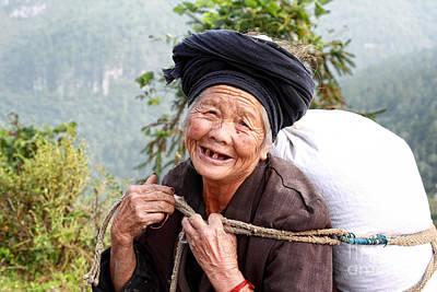 Elderly Miao Woman On Mountain Road Art Print by Charline Xia