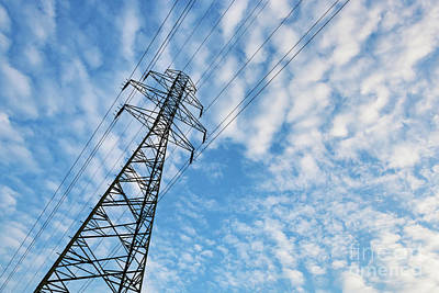 Electrical Photograph - Electricity Transmission Pylon Against Blue Sky With Fluffy Clouds by Michal Bednarek