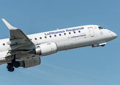 Air Photograph - Embraer E190 Wing And Nose by Roberto Chiartano