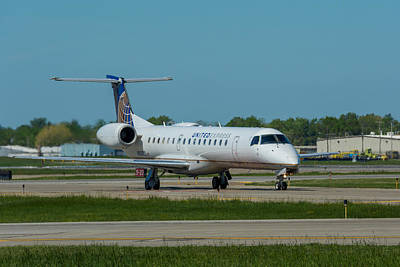 Photograph - Embraer Emb-145 by Guy Whiteley