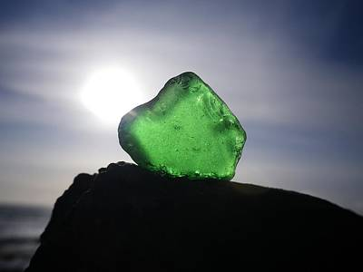 Photograph - Emerald Sea Glass On Rock by Richard Brookes