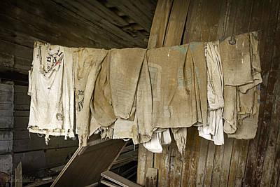 Photograph - Empty Hanging Grain Sacks by LeeAnn McLaneGoetz McLaneGoetzStudioLLCcom