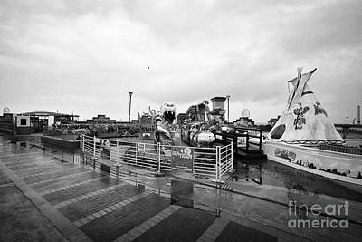 Fun Rhyl Photograph - Empty Outdoor Amusement Park On A Cold Wet British Summer Day North Wales Uk by Joe Fox