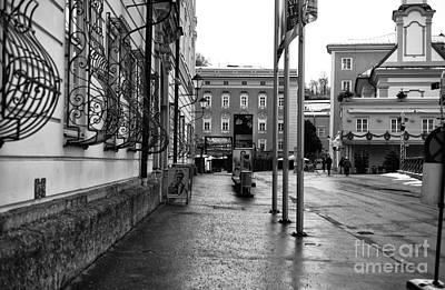 Empty Sidewalk In Salzburg Mono Art Print by John Rizzuto