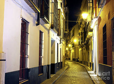 Photograph - Empty Street At Night In Seville by John Rizzuto