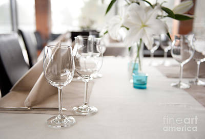 Empty Wineglasses And White Lilium Lily Flowers  Art Print by Arletta Cwalina