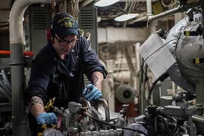 Photograph - Engine Man Works On A Lube Oil Purifier Aboard The Amphibious Transport. Dock Uss Green Bay by Paul Fearn