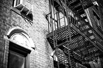 Photograph - Escape On 4th Street by John Rizzuto
