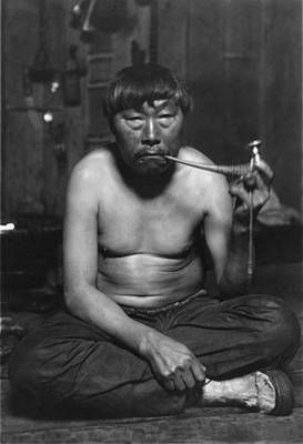 Eskimo Smoking Pipe, Photograph Art Print by Everett