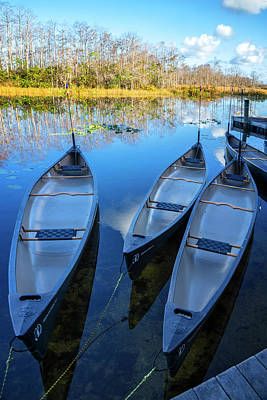 Photograph - Evening Canoes At The Dock by Debra and Dave Vanderlaan