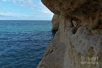 Photograph - Exploring The Cliffs In Carvalho Beach. Algarve by Angelo DeVal