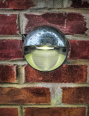 Photograph - Eye Shaped Light On Brick Wall by Gary Slawsky