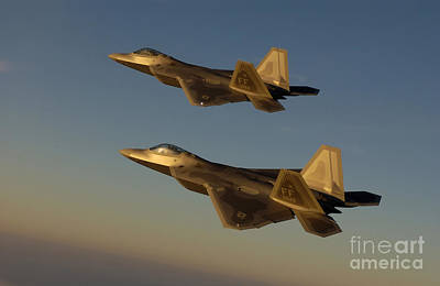 Photograph - F-22a Raptors Fly Over Langley Air by Stocktrek Images