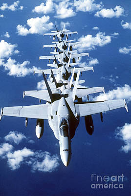 F-18 Photograph - Fa-18c Hornet Aircraft Fly In Formation by Stocktrek Images