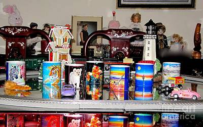 Photograph - Faa Mugs Train And Toys In Background by Phyllis Kaltenbach