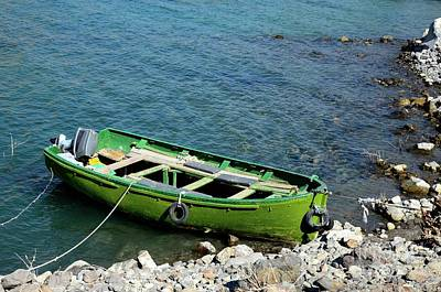Photograph - Faded Green Yellow Motor Power Boat Parked At Satpara Lake Pakistan by Imran Ahmed
