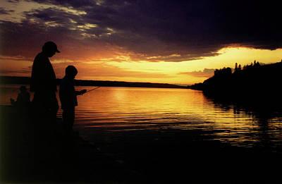 Glenmore Reservoir Photograph - Family Fishing Sunset by Al Bourassa